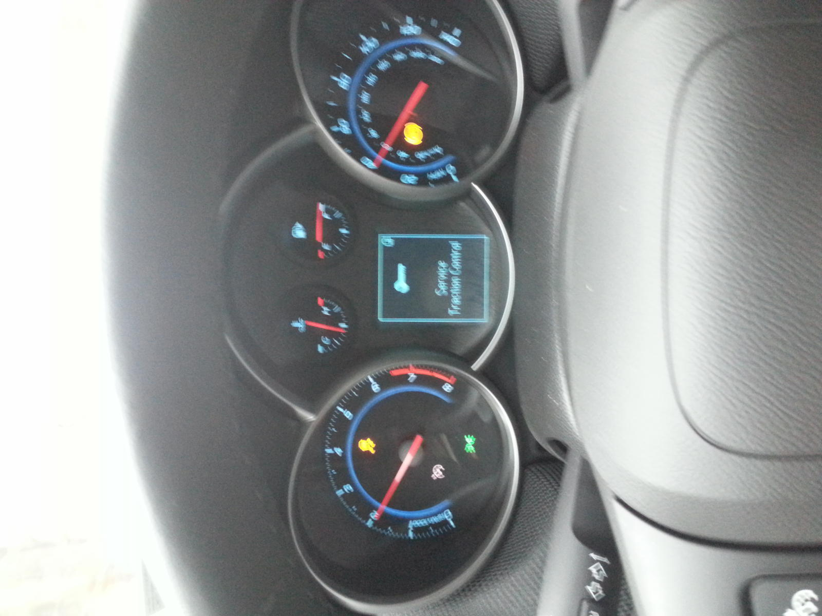 2013 chevy cruze service traction control light